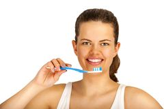 Young woman with toothbrush isolated over white background. Young woman brushing teeth over white backgrund. Smiling showing white teeth`s Stock Photo
