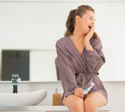 Young woman with toothbrush yawning Royalty Free Stock Photos