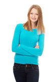 Young woman with toothy smile. Happy teen woman with folded arms Royalty Free Stock Photos