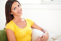 Young woman toothy smiling at the camera Royalty Free Stock Photography