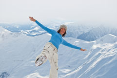 Young woman on the top. Of the mountain Stock Image