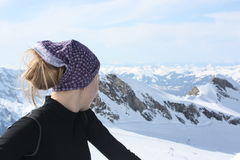 Young woman on the top of the mountain. Stock Images