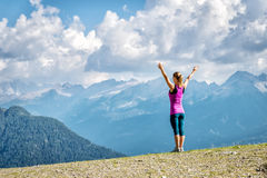 Young woman on top of the mountain. With the arms raised Stock Photos