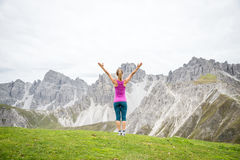 Young woman on top of the mountain. With the arms raised Stock Image