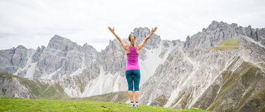 Young woman on top of the mountain. With the arms raised Royalty Free Stock Photo
