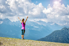 Young woman on top of the mountain. With the arms raised Stock Images