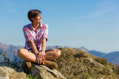 Young Woman at Top of Mountain Stock Image