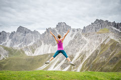 Young woman on top of the mountain Stock Photos