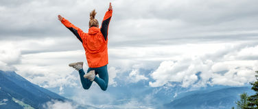Young woman on top of the mountain Stock Images