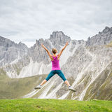 Young woman on top of the mountain Royalty Free Stock Photography
