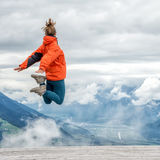 Young woman on top of the mountain Stock Photography