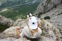 Young woman on top of mountain Royalty Free Stock Image