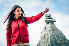 Young Woman At The Top Of The Mountain. Shot taken in Swiss Alps, near Rhone Glacier and Furka Pass Stock Image