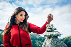 Young Woman At The Top Of The Mountain. Shot taken in Swiss Alps, near Rhone Glacier and Furka Pass Royalty Free Stock Photos