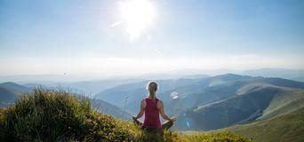 Young woman on the top of mountain. Young woman meditate on the top of mountain royalty free stock photography