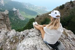 Young woman on top of mountain Royalty Free Stock Images
