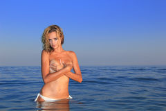 Young woman topless in water Royalty Free Stock Photography