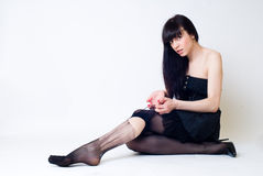 Young woman in torn stockings Stock Photo