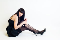 Young woman in torn stockings Stock Photography
