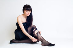 Young woman in torn stockings Royalty Free Stock Photos