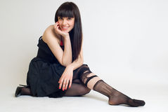 Young woman in torn stockings. Young brunette woman in torn stockings at white background stock photos