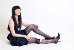 Young woman in torn stockings Royalty Free Stock Photography