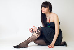 Young woman in torn stockings Royalty Free Stock Photo