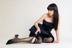 Young woman in torn stockings Stock Image