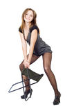 Young woman in the torn stockings Royalty Free Stock Photo