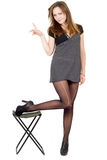 Young woman in the torn stockings Stock Image