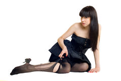 Young woman in torn stockings Royalty Free Stock Images