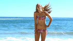 Young woman tossing her hair on the beach stock video footage