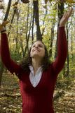 Young Woman Tossing Leaves Stock Photography