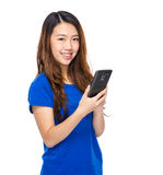 Young woman touch on cell phone Stock Photos