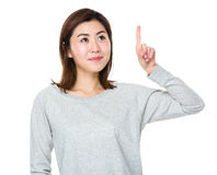 Young woman touch on imaginary button Stock Images