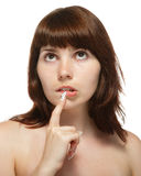 Young woman touched his finger to his lips. Young woman touched his finger to his lips, isolated on a white background Royalty Free Stock Images
