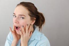Young woman touching cheeks self-massage Royalty Free Stock Photo