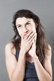 Young woman touching face and mouth for imagination Royalty Free Stock Photo