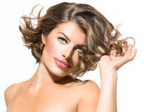 Young Woman Touching Hair. Beauty Young Woman Touching Hair over White Background Stock Images
