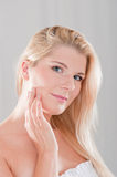 Young woman touching healthy skin Royalty Free Stock Images