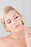 Young woman touching healthy skin Stock Images