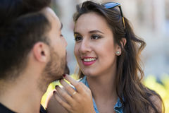 Young woman touching her boyfriend face. Close up portrait of young women touching her boyfriend face Royalty Free Stock Photo