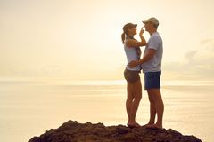 Young woman touching her boyfriend nose and smiling while standi Stock Photo