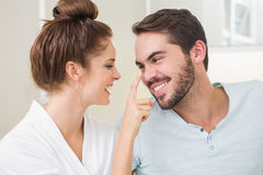 Young woman touching her boyfriends nose Royalty Free Stock Image