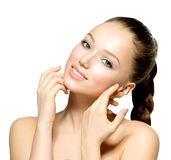Young Woman touching her Face Royalty Free Stock Image