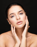 Young woman touching her face. Beauty girl Stock Photography