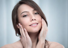 Young woman touching her face royalty free stock photo
