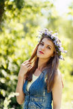 Young woman touching her hair, portrait at nature Royalty Free Stock Photo