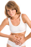 Young woman touching her stomach Royalty Free Stock Photos