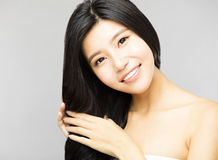 Young Woman touching  Long and Healthy Black  Hair Stock Photos